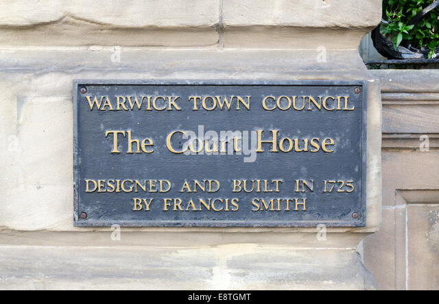 Wall-mounted plaque for The Court House in Warwick - Stock Image