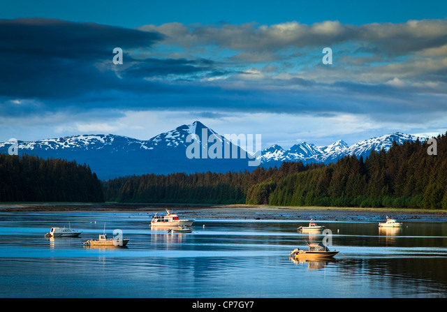 Scenic evening view of Bartlett Cove and moored fishing boats, Glacier Bay National Park & Preserve, Southeast - Stock Image