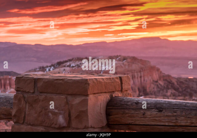 Stone Pillar of Fence at Sunrise along Bryce Canyon rim - Stock Image