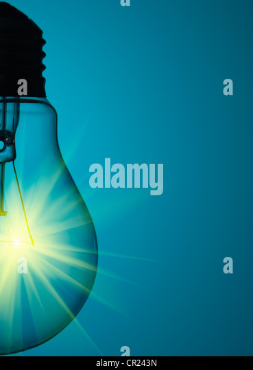 Close up of glowing light bulb - Stock Image