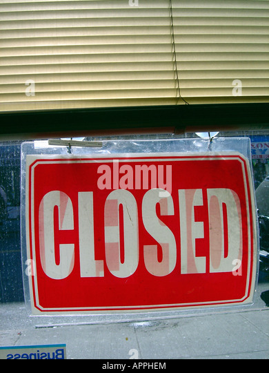 Red and White Closed Sign at a Commercial Business - Stock Image