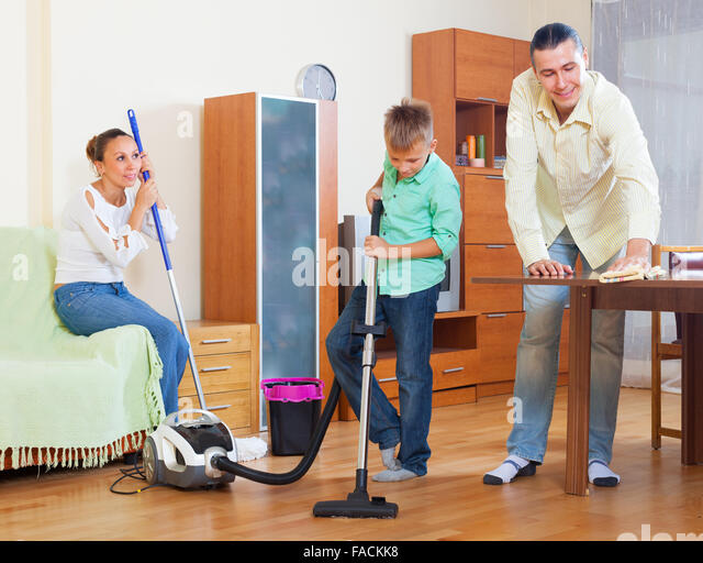 teenager vacuum stock photos teenager vacuum stock 14314 | ordinary family of three with teenager doing house cleaning with cleaning fackk8