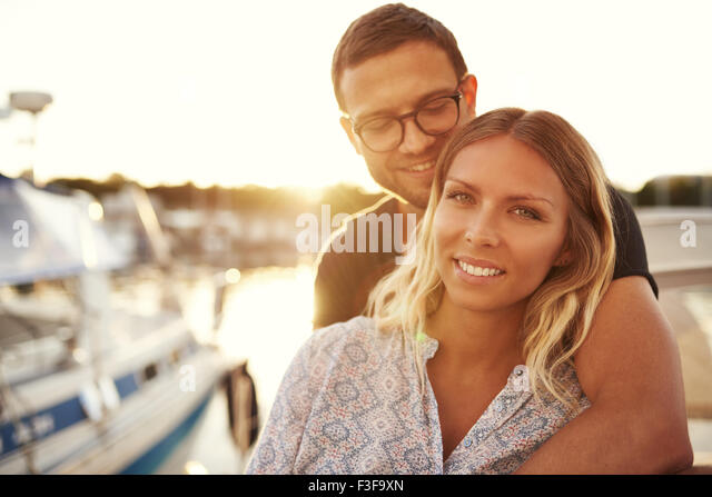 White Loving Couple on A Boat, Smiling at Camera - Stock-Bilder