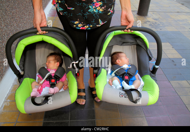 Mendoza Argentina Avenida San Martin Hispanic baby infant boy girl twins multi-use car seat safety seat restraint - Stock Image