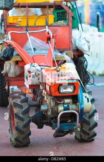 A farmer bulldozer converted to cargo puller. - Stock Image