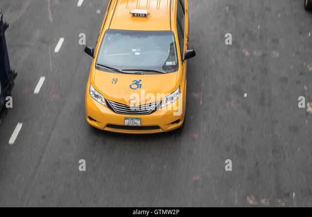 A yellow cab minivan in New York City - Stock Image