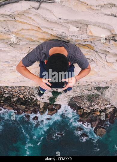 High Angle View Of Man Photographing Sea - Stock-Bilder