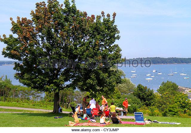 Portland Maine Casco Bay Eastern Promenade Park scenic lawn family picnic tree - Stock Image