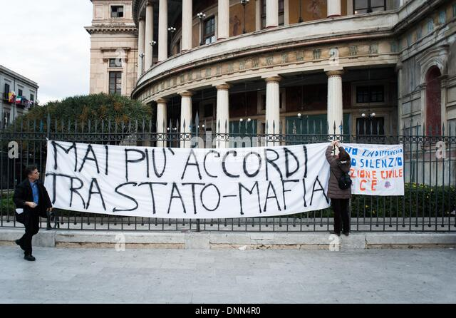 Palermo, Italy. 20th Dec, 2013. Palermo, Dec. 20, 2013 - A woman is hanging up a protest banner that reads:'' - Stock Image