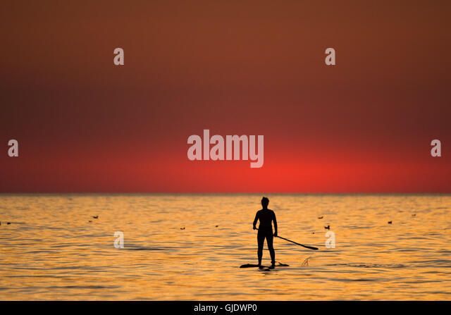 Aberystwyth, Wales, UK. 15th August, 2016. UK Weather: At the end of a day of unbroken warm sunny weather, a young - Stock Image