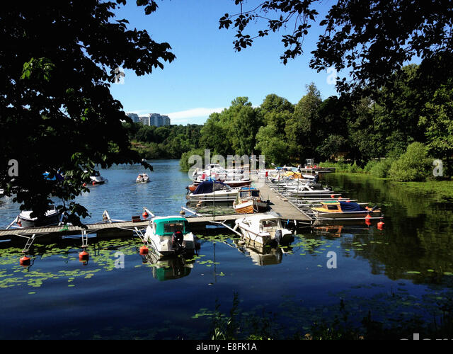 Sweden, Svealand, Stockholm, Boats and jetty - Stock Image