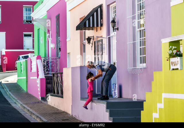 South Africa African Cape Town Bo-Kaap Schotsche Kloof Malay Quarter Muslim neighborhood Chiappini Street man woman - Stock Image
