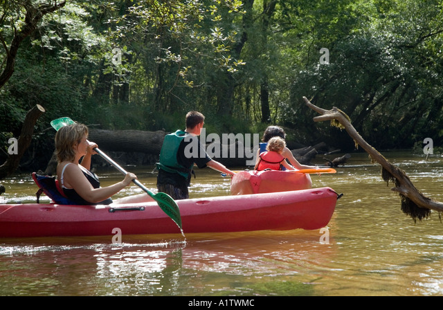 Group of people canoeing Eyre river France - Stock Image