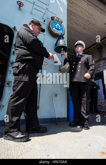 The bell is rung for every RCN ship lost in WW2 during the 2016 Battle of the Atlantic Committal Service from HMCS - Stock Image