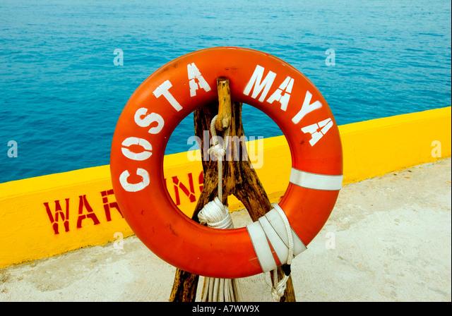 Puerto Costa Maya pier orange and white lifering sign - Stock Image