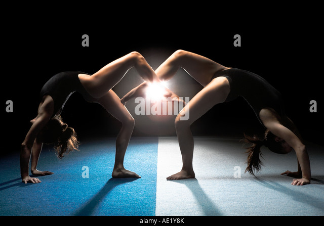 Two ballet gymnasts making a bridge arch - Stock Image