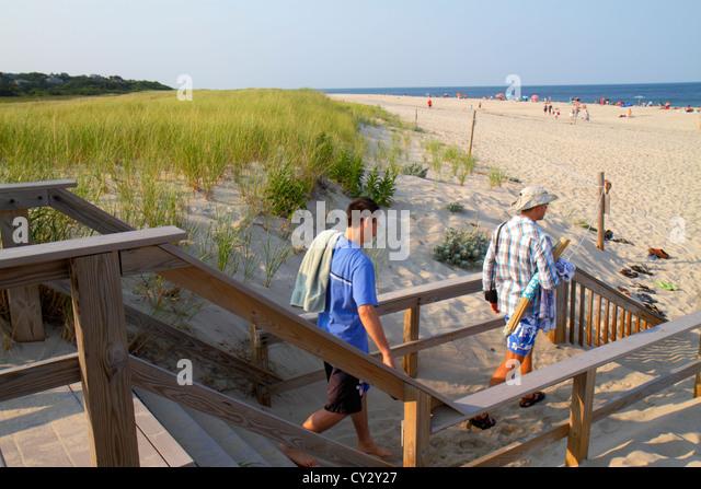 Massachusetts Cape Cod Nauset Beach Cape Cod National Seashore dune grass sand sunbathers man Atlantic Ocean - Stock Image