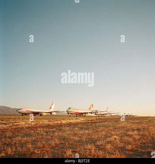 In mid-day heat of the arid Sonoran desert sit the remains of airliners at the storage facility at Mojave. - Stock Image