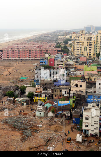Poor community apartments at Foreshore Estate Beach in Chennai, India - Stock Image