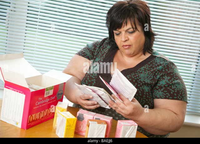 a woman with the Cambridge Diet weight loss program formula food - Stock Image