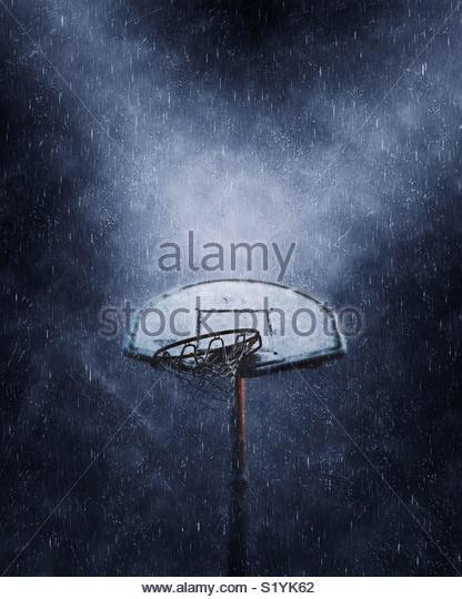 Basketball basket in the rain - Stock Image