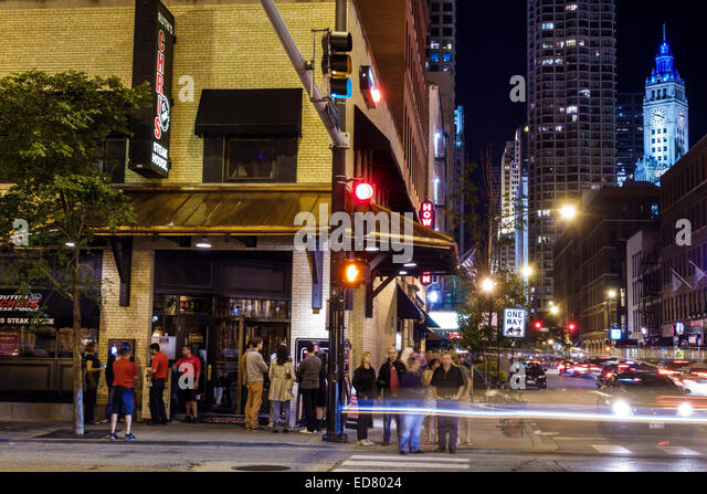 Illinois Chicago River North downtown North Dearborn Street night nightlife buildings - Stock Image