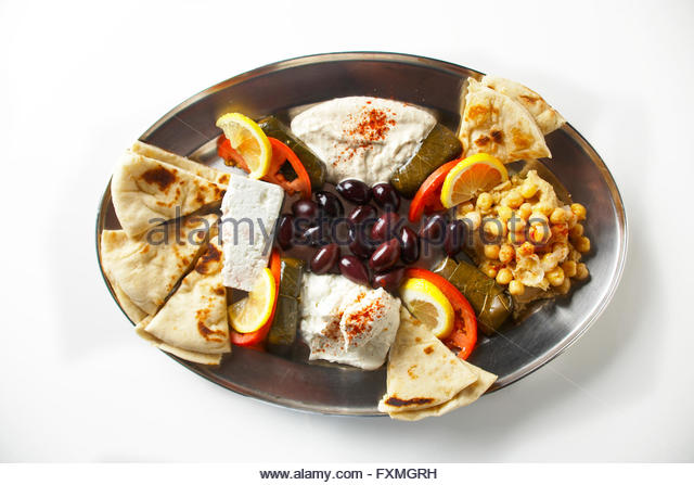 Feta cheese,chick peas, black olives,pita bread,and grape leaf spinach pockets vegetarian platter - Stock Image