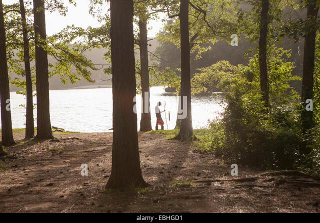 Teenage boy fishing at forest lake, Arkansas, USA - Stock Image