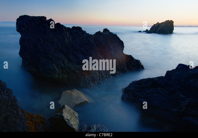 Urchin Rocks with Vancouver Island in distance, Deception Pass State Park, Fidalgo Island, Washington, USA - Stock Image