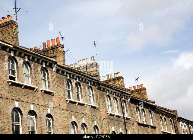 Victorian roof top chimneys - Stock Image
