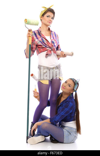 Two fun girls are going to do painting walls. - Stock Image