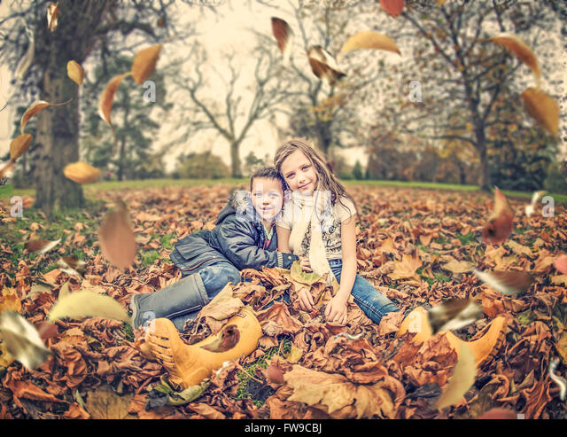 two children in park in autumn - Stock Image