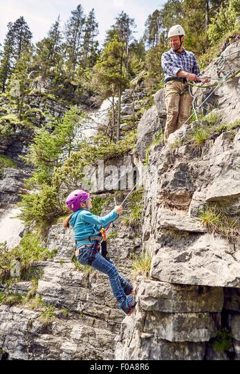 Father and child rock climbing, Ehrwald, Tyrol, Austria - Stock Image