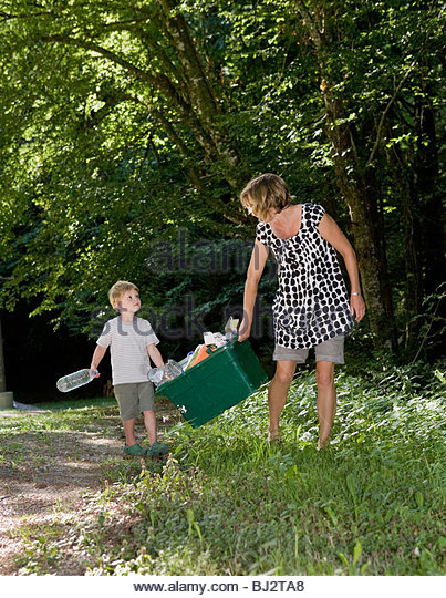 boy and mother recycling waste - Stock Image