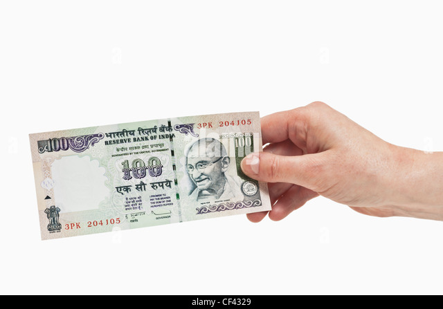 One Indian 100 rupees bill with the portrait of Mahatma Gandhi is held in the hand, Background white. - Stock-Bilder