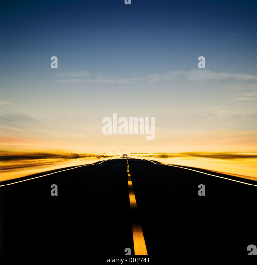 vibrant image of highway and blue sky - Stock Image