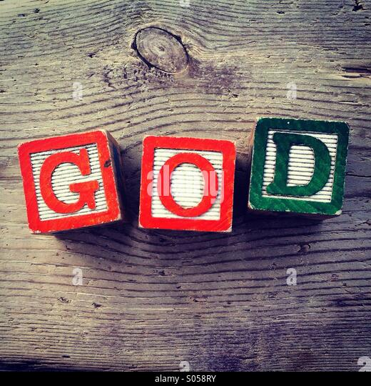It's a photo of two wood cubes toy with letters that form the word GOD - Stock Image