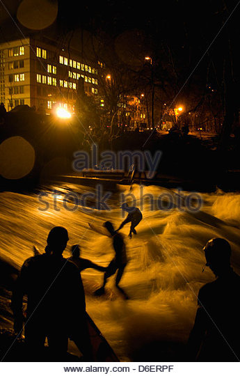 Surfers in Eisbach Munich Bavaria Germany - Stock Image
