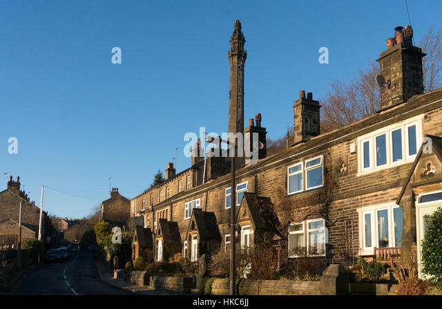 Row of Victorian terraced cottages below Wainhouse Tower, Halifax, West Yorkshire - Stock Image