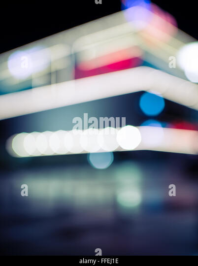 Abstract dark blurry urban background. City at night. - Stock Image