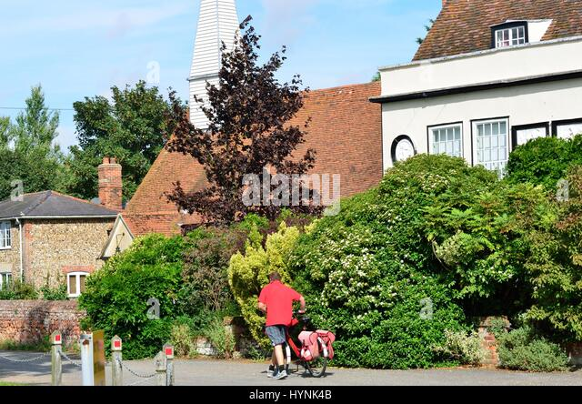 CHAPPEL ESSEX UK  31 August 2014: Traditional village scene with postman - Stock Image