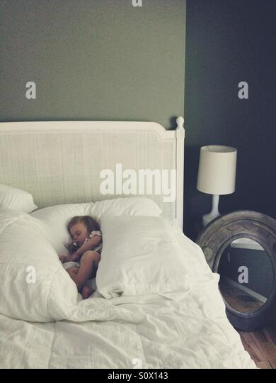 Sleeping baby girl. - Stock Image
