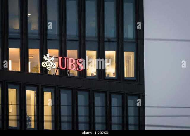 Early in the morning, the lights are switched on in some offices of a UBS bank office building at Zurich, Switzerland. - Stock Image