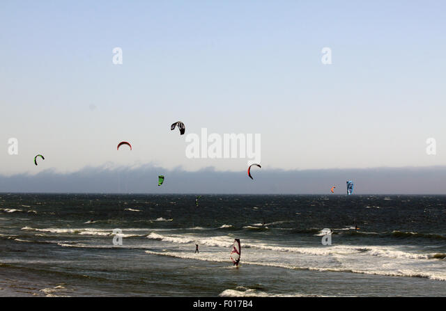 Wind surfing along the Pacific Ocean - Stock Image