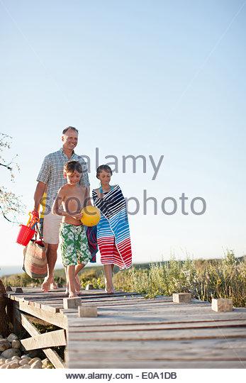 Family preparing to go to beach - Stock-Bilder