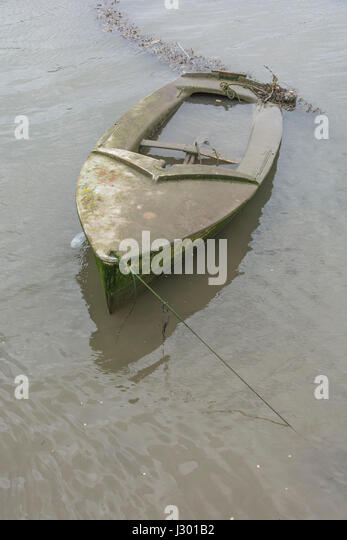 Waterlogged boat as visual metaphor for 'sinking the ship',  'sink the boat', organisational failure, - Stock Image