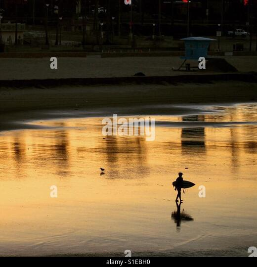 Sunrise surfer - Stock Image