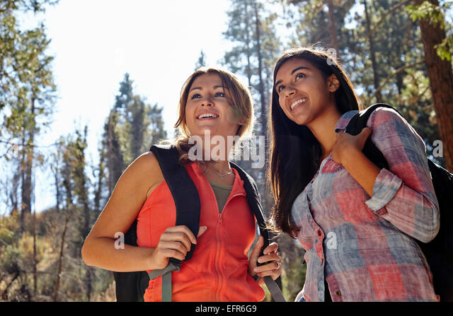 Two young adult females hiking in forest, Los Angeles, California, USA - Stock Image