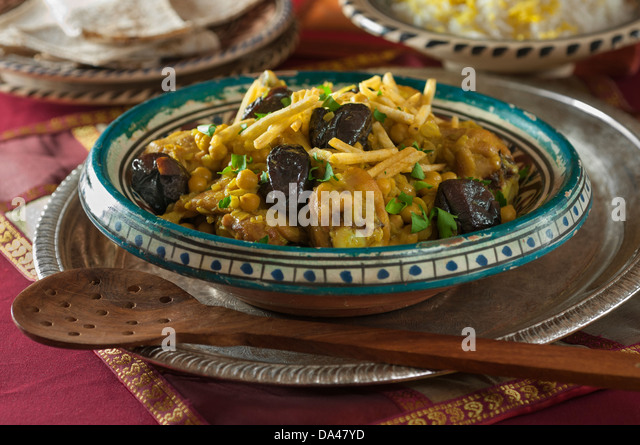 Chicken Khoresht with dried plums and chick peas. Iran Food - Stock Image