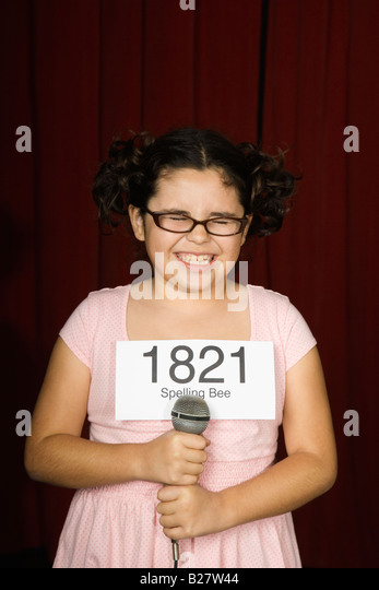 Girl wearing number on stage - Stock Image